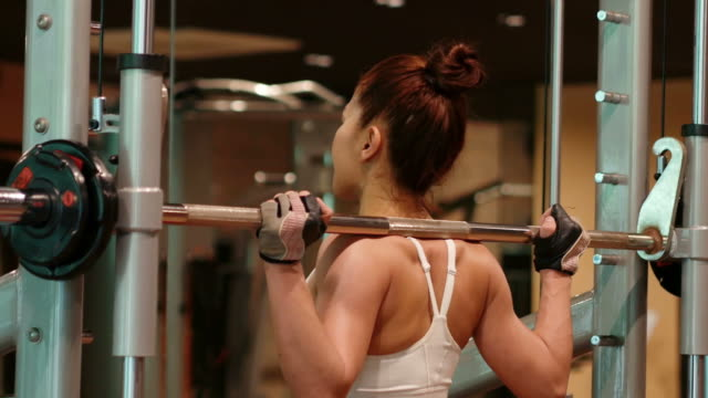 asian sexy woman workout in gym - muscular contraction stock videos and b-roll footage