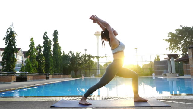 asian sexy woman workout yoga and pilates , sun flare - deltoid stock videos and b-roll footage