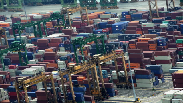 asian shipping container port part of tiger economy - stretto video stock e b–roll