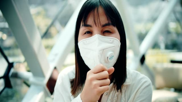 asian sick woman with protective mask - pollution mask stock videos and b-roll footage