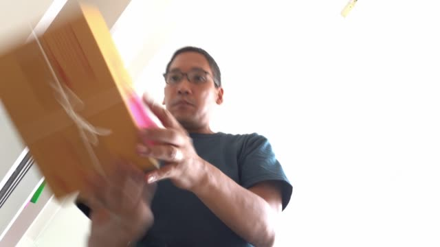 asian small business man work at home, online business owner packing cardboard boxes ready to sending to delivery company. - small stock videos & royalty-free footage