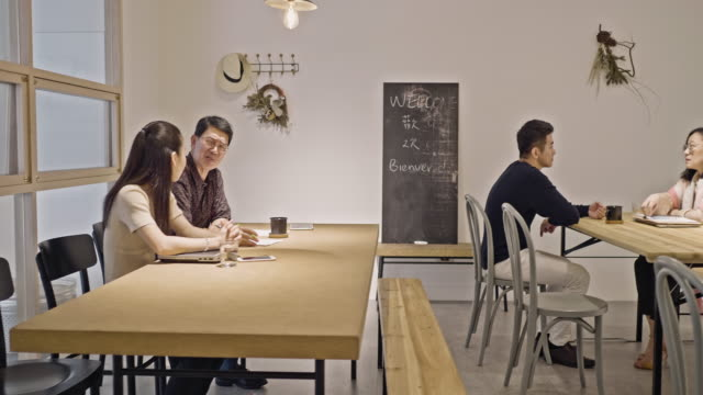 Asian Small Business Owners Sharing Flex Office Space