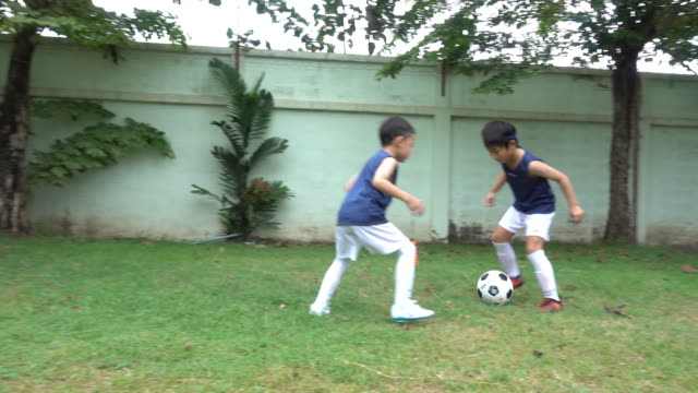 asian soccer kids prepare - soccer sport stock videos & royalty-free footage