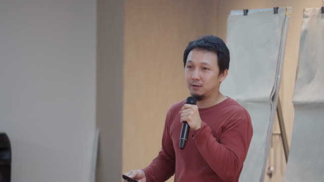 asian speaker with casual suit presenting in front of the seminar meeting room or conference hall - public speaker stock videos & royalty-free footage