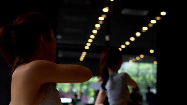 asian sport woman and caucasian white training yoga in yoga studio coaching by trainer,open light from nature.healthy,city life style concept.slow motion footage. - human limb stock videos & royalty-free footage