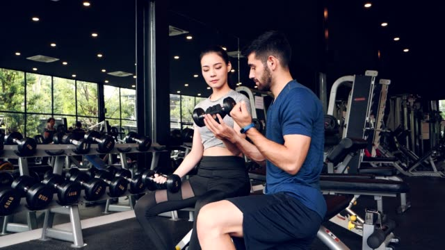 asian sport woman  during lift weight with take care by trainer.healthy,city life style concept.slow motion footage. - bench press stock videos & royalty-free footage