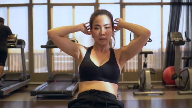 asian sport women doing sit-ups in gym - sit ups stock videos & royalty-free footage