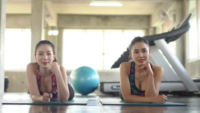 asian sporty woman, model acting rest and relaxation after yoga class, take a photo by photographer. - acting stock videos & royalty-free footage