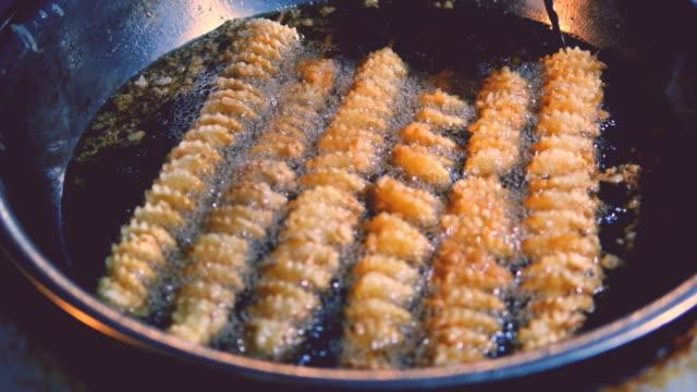 asian street food : deep fried potato - fried potato stock videos and b-roll footage