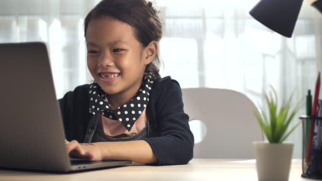 asian students learning via computer at home, homeschooling - little girl webcam stock videos & royalty-free footage