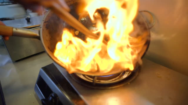 asian style cooking on a fire pan (wok) - retail occupation stock videos & royalty-free footage