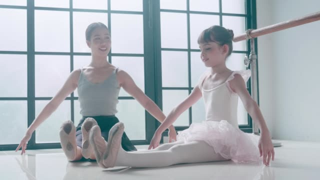 asian teacher and her cute ballerina girl with ballet dancing class - ballet shoe stock videos & royalty-free footage