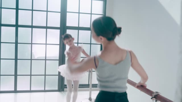 asian teacher and her cute ballerina girl with ballet dancing class - leotard stock videos & royalty-free footage