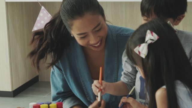 asian teacher teaching student in art class - nursery school building stock videos & royalty-free footage