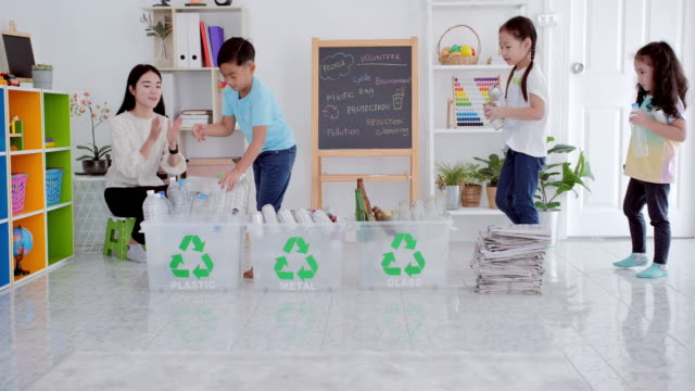 asian teacher women with children teaching student how to recycle household waste.charity, people and ecology, recycling and ecology.lifestyle - ecological education and awareness,recycling in daily life concept.teaching children about sustainability - ease stock videos & royalty-free footage