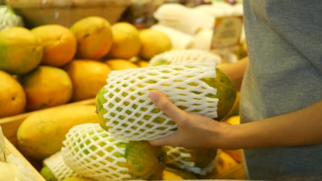asian teenage woman shopping in supermarket - papaya stock videos & royalty-free footage