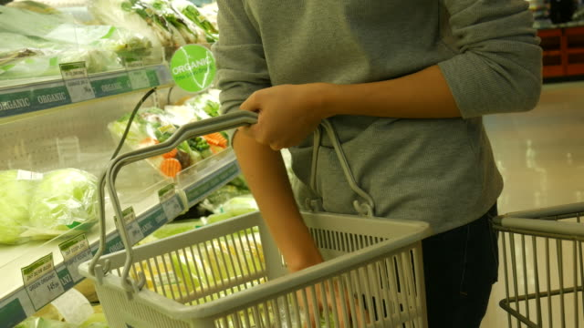 asian teenage woman shopping in supermarket - nutritionist stock videos and b-roll footage