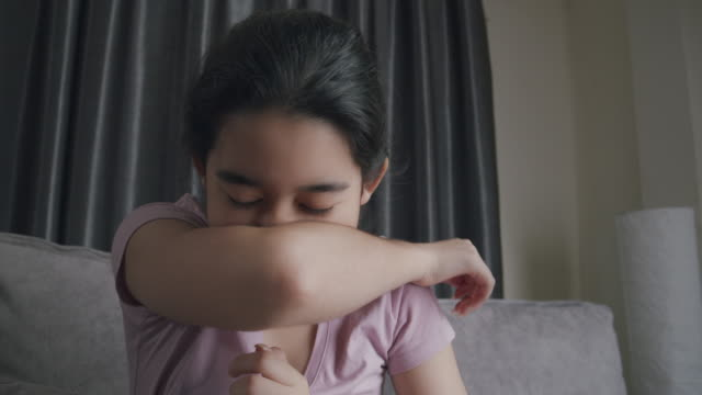 asian teenager sneezing blowing her nose with a napkin from flu. she has allergy. young. girl sick with flu at home - sneezing stock videos & royalty-free footage
