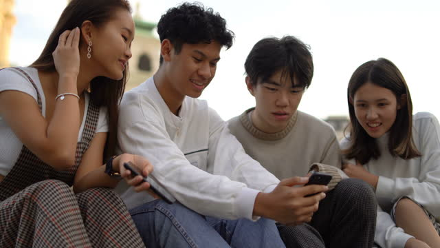 asian teenagers hanging out outdoors - teenage boys stock videos & royalty-free footage