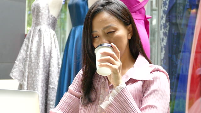asian thai woman drink hot coffee at shopping mall - coffee drink stock videos & royalty-free footage