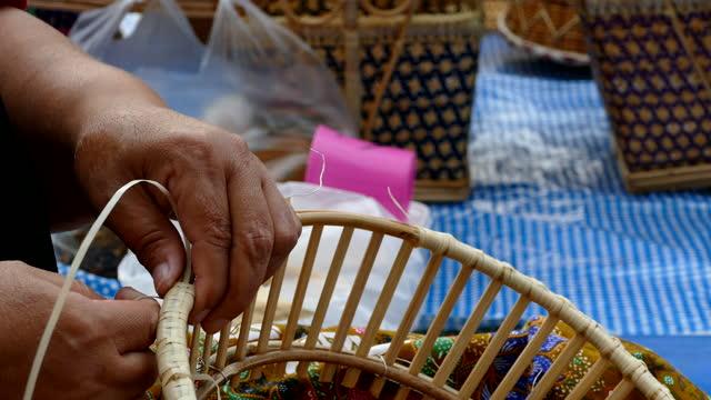 asian thai women weaving making bamboo basket - tradition stock videos & royalty-free footage