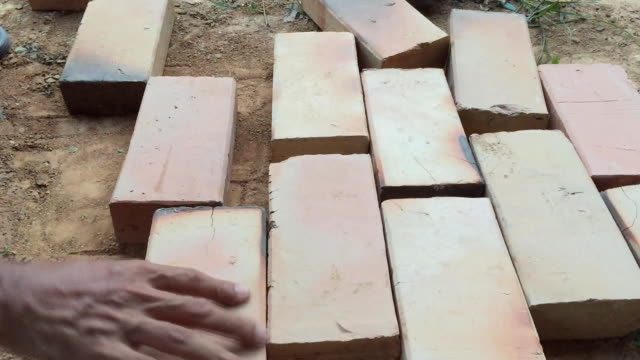 asian thai worker laying bricks making new sidewalk - labour party stock videos & royalty-free footage