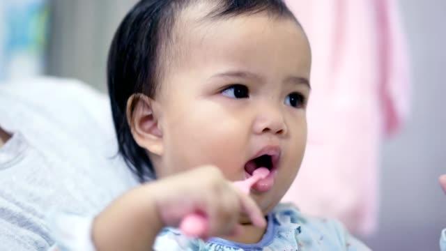 asian toddler (baby girl) brushing teeth - baby girls stock videos & royalty-free footage