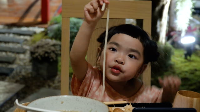 asian toddler eating and playing udon noodle - messy stock videos & royalty-free footage