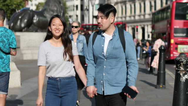 asian tourist couple walking in london england - chinese ethnicity stock videos & royalty-free footage