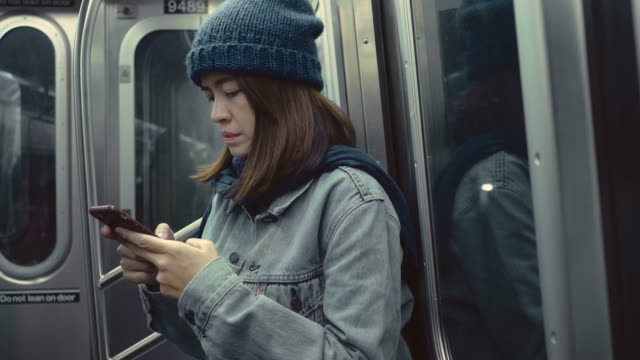 asian tourist texting in a subway - railway station platform stock videos & royalty-free footage
