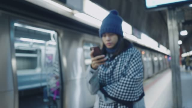 asian tourist texting in a subway - subway train stock videos & royalty-free footage
