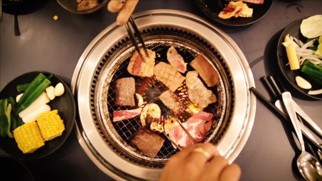 asian tourists eating bbq in tokyo - curiosity stock videos & royalty-free footage