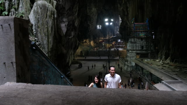 asian tourists visiting the batu caves - malaysian culture stock videos and b-roll footage