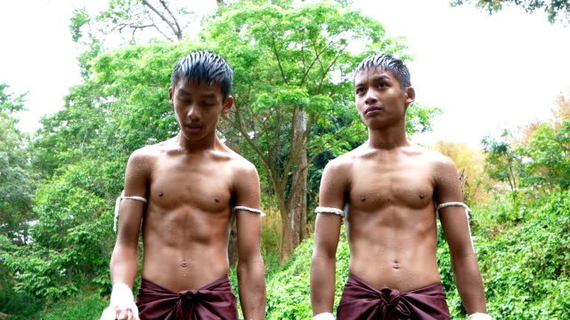 asian twin boys training muay thai or thai boxing in thailand - muay thai stock videos and b-roll footage
