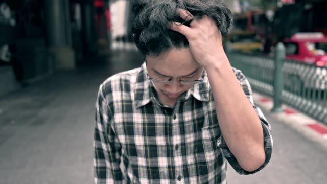 asian unemployed man stressed. anxiety in adult cause to depression and a problem in living that drag you down to feeling sadness,lonely and worried. - worried stock videos & royalty-free footage