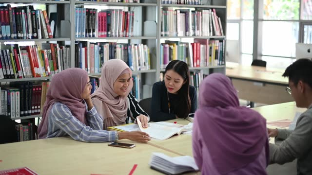 asian university student studying in library - training course stock videos & royalty-free footage