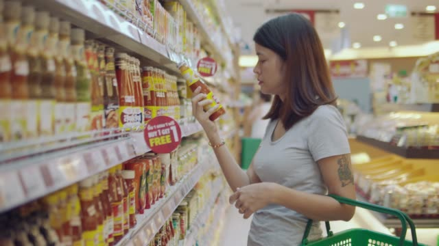 asian wife in grocery store - shelf stock videos and b-roll footage