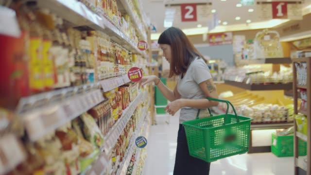 asian wife in grocery store - aisle stock videos & royalty-free footage