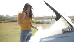 Asian with Woman Car broken down on road opening the radiator bonnet Car and see engines