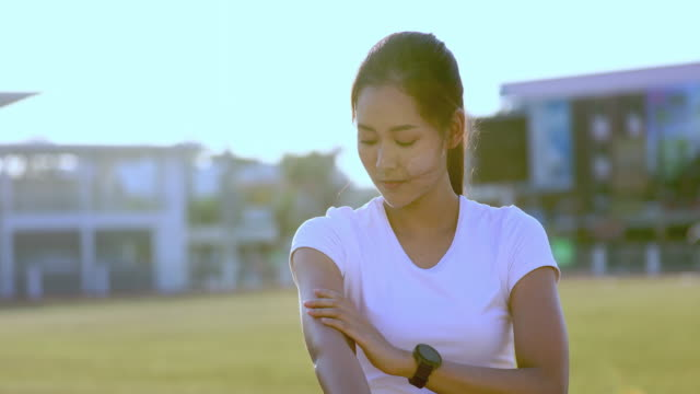 asian woman applying and spraying sunscreen cream on skin before run. sports and healthy concept - pacific islands stock videos & royalty-free footage