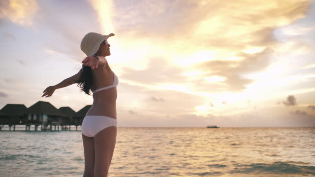 asian woman arms raised on beach, freedom - etereo video stock e b–roll