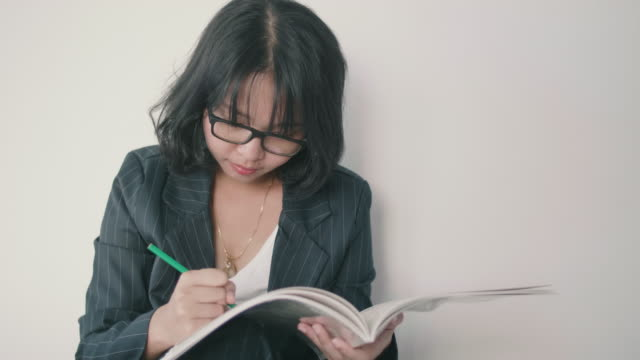 asian woman at home with adult coloring books. - colored pencil stock videos and b-roll footage