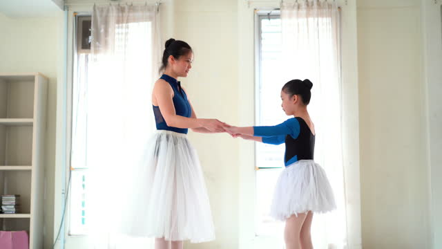 asian woman ballet teacher training her young girl student in studio - dress stock videos & royalty-free footage