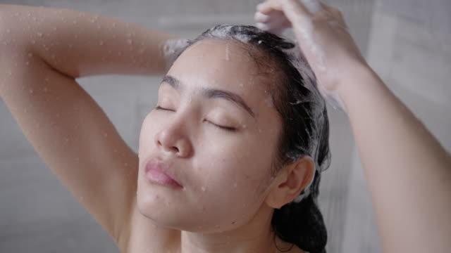 asian woman bathing and washing her hair. - washing hair stock videos & royalty-free footage