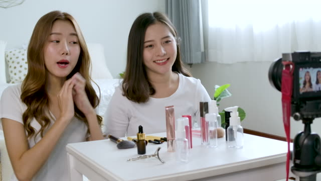 asian woman blogger is showing how to make up and use cosmetics. - blogging stock videos & royalty-free footage