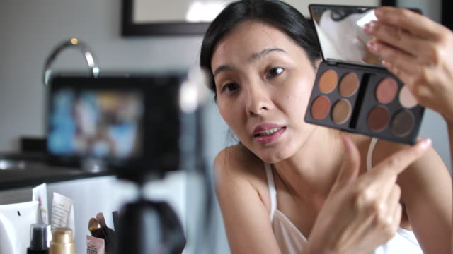 asian woman blogger talking to camera for recording vlog video with makeup cosmetic at home - fashion collection stock videos & royalty-free footage