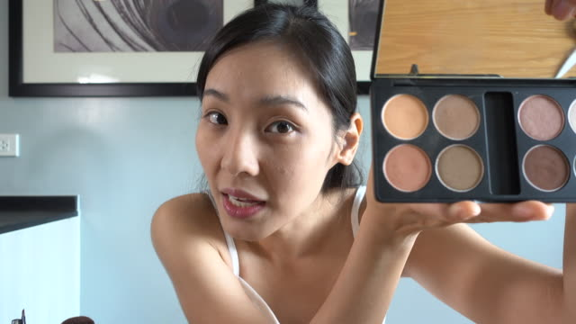 asian woman blogger talking to camera for recording vlog video with makeup cosmetic at home - tutorial stock videos and b-roll footage
