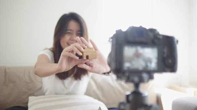 asian woman blogger with camera recording video and talking up at home - media training stock videos and b-roll footage