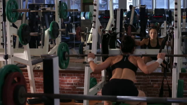 a asian woman body builder doing squirt at the gym - squirting woman stock videos and b-roll footage