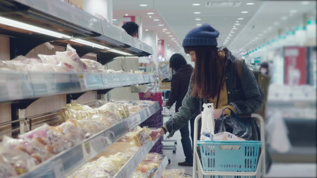 Asian woman buying bakery products